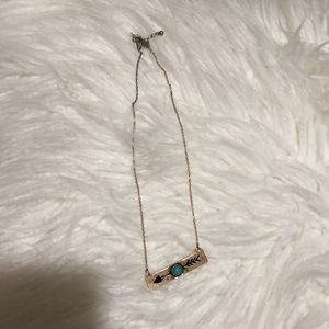 Turquoise arrow necklace.